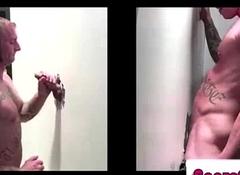 Muscular gay gives tugjob to naked straight at gloryhole