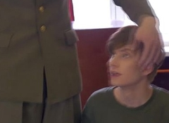 Uniformed officers spitroasting lad cadet