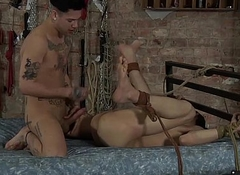 Tied up Luke receives blowjob and anal from horny Mickey