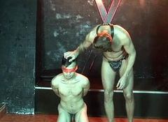 Nude young slave gets blindfolded at the oubliette